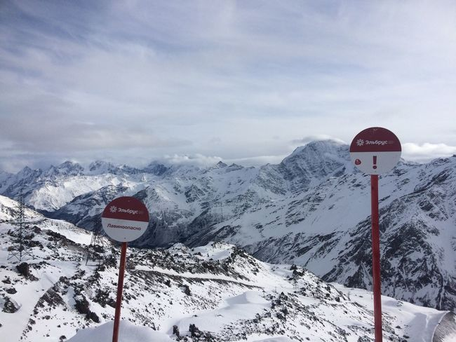 Snow Winter Cold Temperature Nature Sky Beauty In Nature Weather Communication Text Outdoors No People Day Road Sign Mountain Caucasus Elbrus
