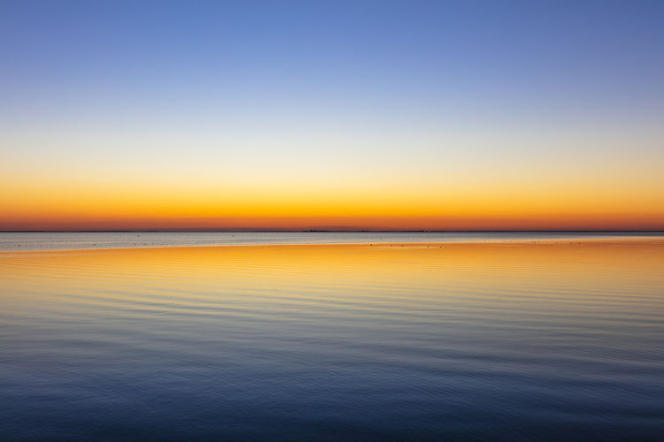 Horizon Sunset Sky Tranquil Scene Water Horizon Over Water Orange Color Idyllic Clear Sky Tranquility Beauty In Nature