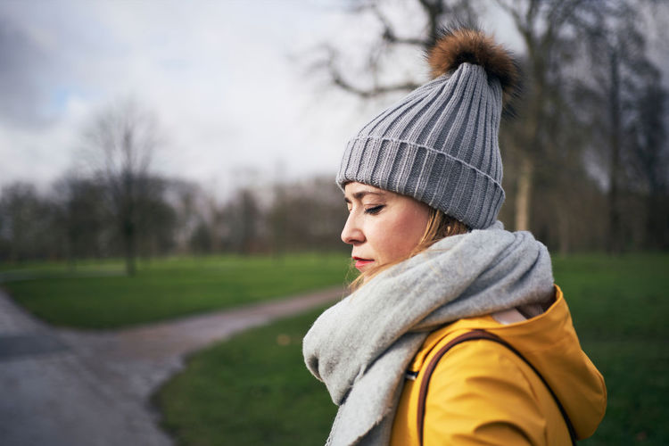 Portrait of mid adult woman looking away in winter