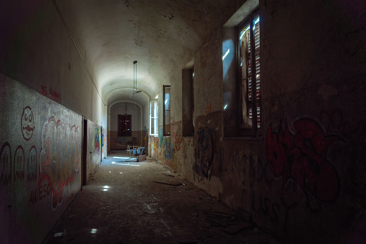 Mental Hospital  Abandoned & Derelict Architecture Building Indoors  Abandoned Built Structure Corridor Arcade Wall - Building Feature No People Damaged Graffiti Wall Empty Arch Direction Bad Condition Old Run-down Spooky Dirty Messy Deterioration Ceiling Ruined