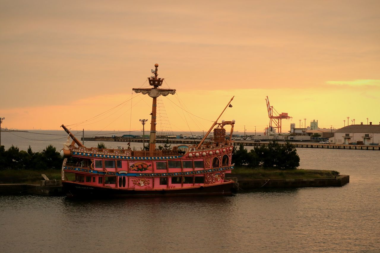sunset, nautical vessel, sky, waterfront, transportation, water, mode of transport, built structure, no people, architecture, outdoors, sea, building exterior, nature, day, drilling rig