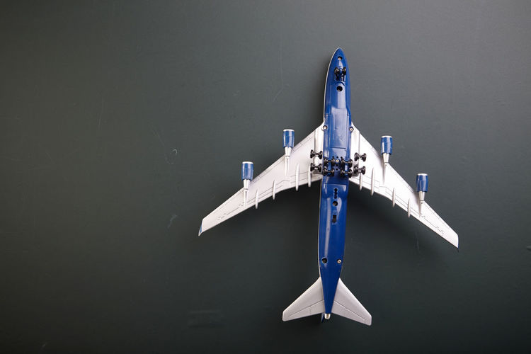 Directly Above Shot Of Toy Airplane On Black Background