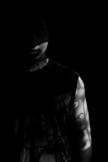 Portrait of man in darkroom