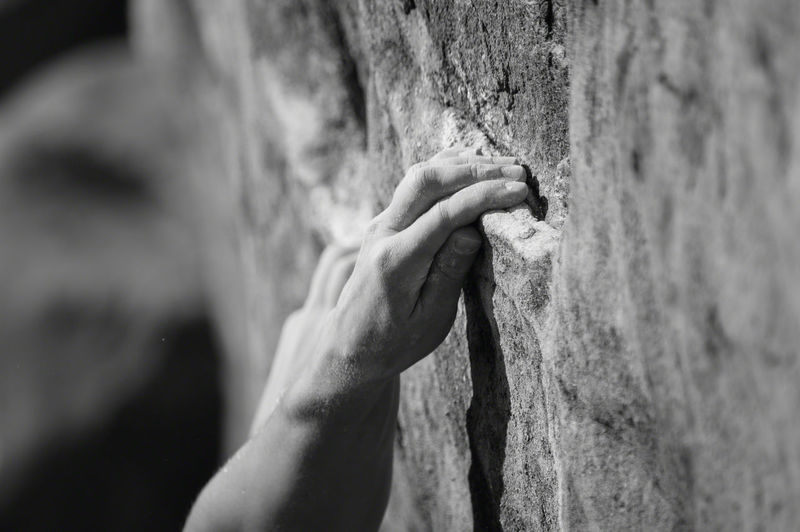 Close-Up Of Man Free Climbing