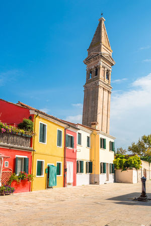 Colorful buildings and a leaning tower of an old church on Burano island, Venice, Italy. Architecture Buildings Burano Burano, Venice Chur Church Citycapes Colorful Colorful Buildings Island Landscape Leaning Tower No People Picturesque Red Sunset Tower Venice Yellow