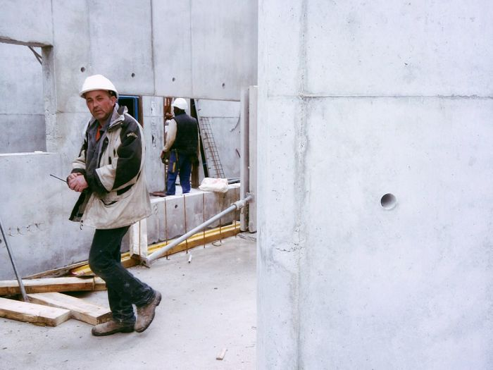 Portrait Of Worker Walking At Construction Site
