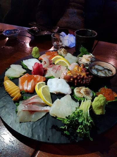 seafood with a cup of sake Low Angle View EyeEm Dinner Business Pleasure Yummy Raw Fish And Sea Foods Sashimi Dinner
