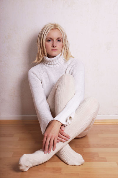 Alone Blond Hair Blonde Casual Dreadlocks Dreads Floor Full Length Girl Jumper Knitted  People Pullover Room Serious Sitting Socks Stockings Sweater Warm Clothing White Woman Woollen Young Adult Young Woman