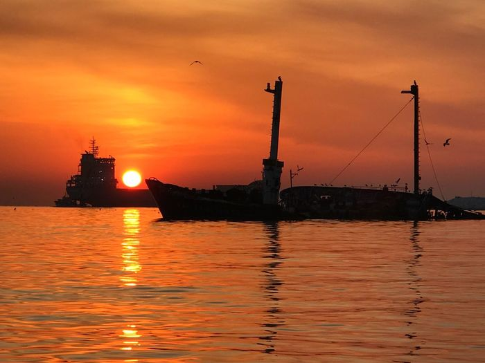 sunrise and cargo ship Sunset Water Sky Orange Color Sea Architecture Transportation Built Structure Cloud - Sky No People Nautical Vessel Nature Reflection Silhouette Waterfront Beauty In Nature Building Exterior Ship Mode Of Transportation Outdoors