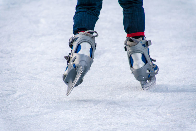 Low section of person skating on ice