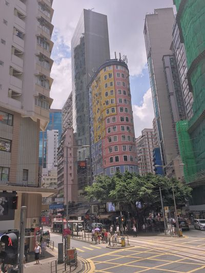 Architecture Skyscraper City Building Exterior Built Structure Modern Street Road Large Group Of People City Life Day Outdoors Sky Tree Cityscape People hongkong HongKong Shek O