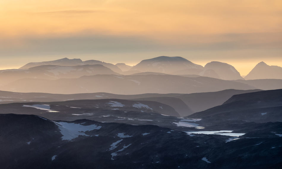 View from the mountain Snøhetta towards north at sunset. Beauty In Nature Scenics - Nature Sky Sunset Mountain Tranquil Scene Tranquility Mountain Range Nature Idyllic Non-urban Scene No People Environment Landscape Outdoors Golden Evening Twilight Blue Mountains Golden Sky Backgrounds