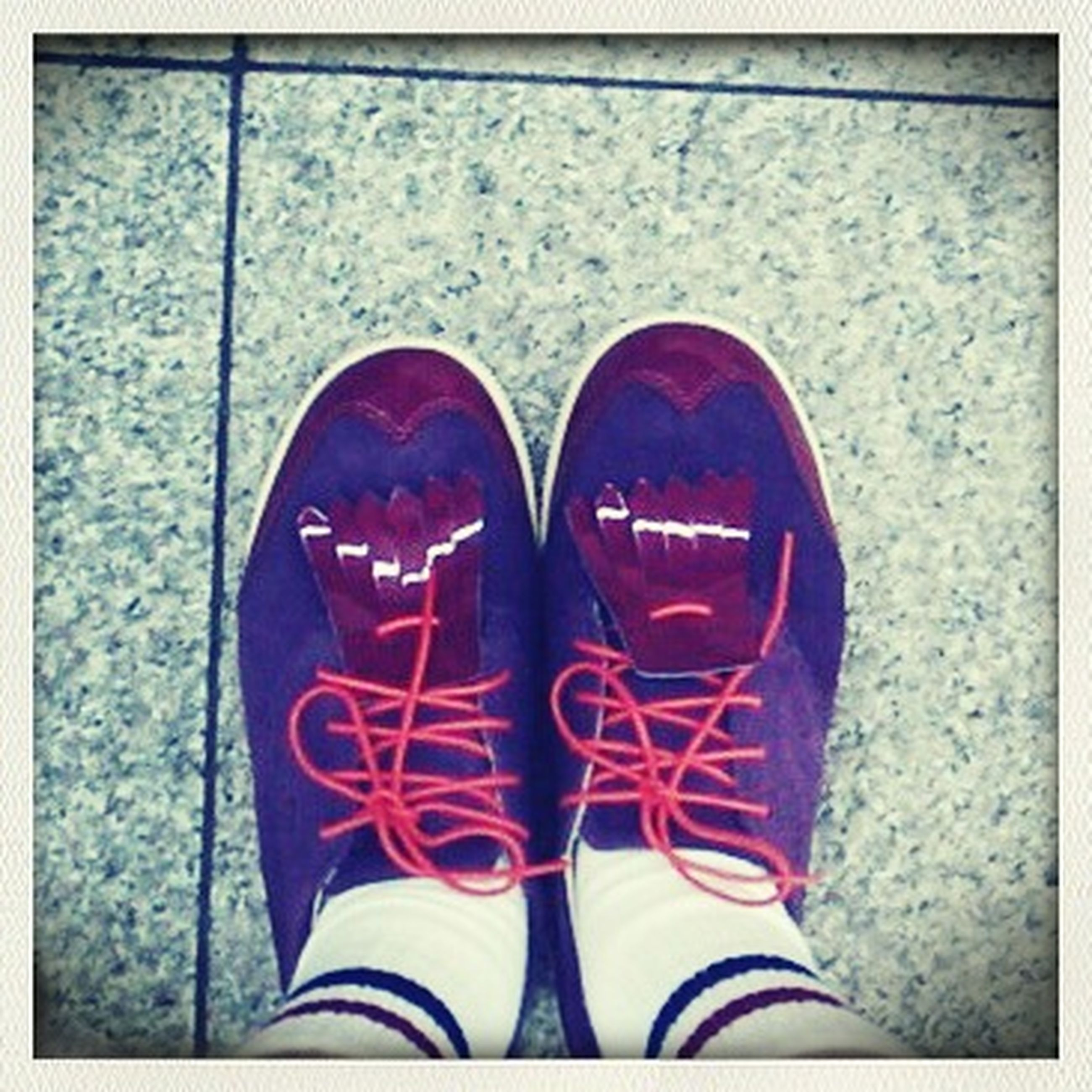 shoe, low section, person, personal perspective, footwear, standing, human foot, lifestyles, transfer print, high angle view, canvas shoe, auto post production filter, pair, men, leisure activity, jeans, street
