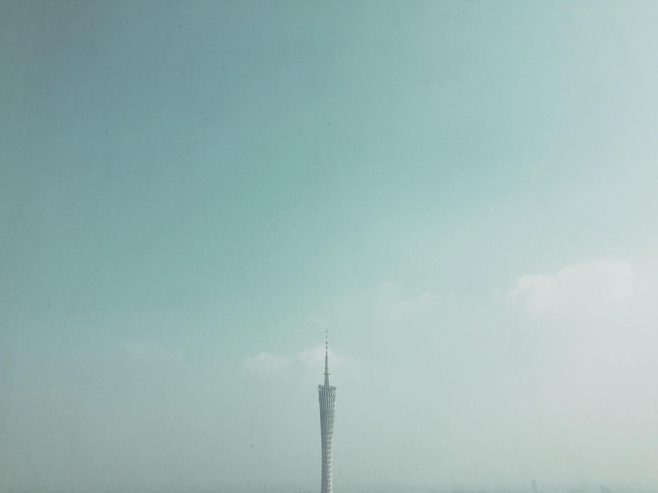 communications tower, low angle view, communication, high section, sky, tower, spire, tall - high, day, cloud - sky, scenics, tall, global communications, cloud, outdoors, tranquility, development, nature, blue, fernsehturm, no people, communication tower, atmosphere