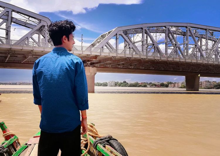 One Person So Tired Sky River One Man Only Only Men Standing Day Casual Clothing Thinking Somone Bridge - Man Made Structure Adults Only Rear View People Adult Connection Arts Culture And EntertainmentVacations Water Outdoors Travel Destinations Men First Eyeem Photo