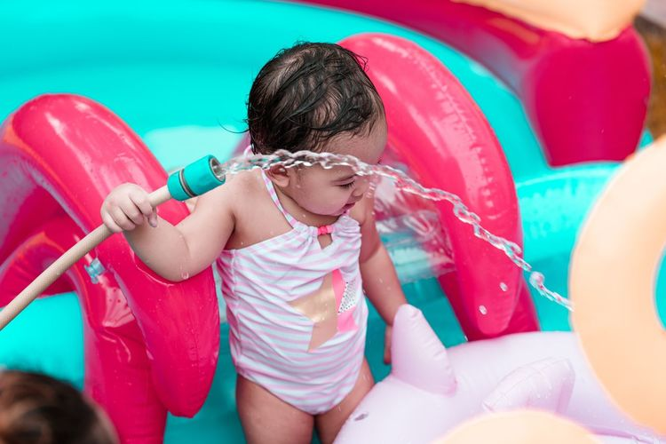 Cute girl playing in swimming pool