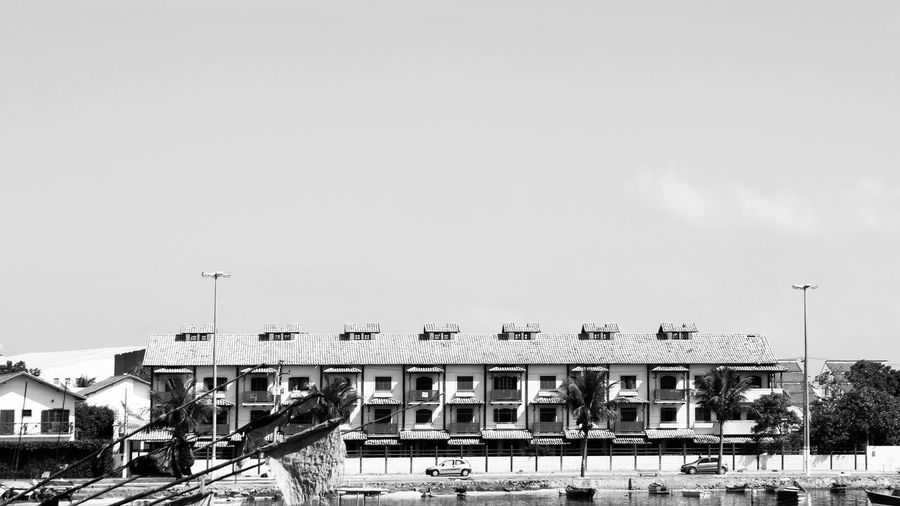 Cabo Frio, Brazil. 16x9 Architecture Balance Blackandwhite Boat Building Built Structure Cabofrio  City City Life Day Geometric House No People Outdoors Rio Da Prata Sea Side By Side Sky Weather Wide