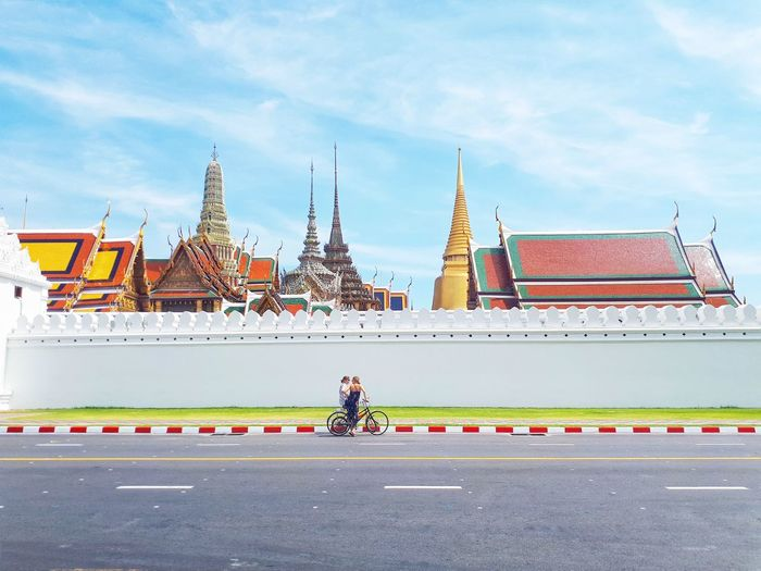BANGKOK, THAILAND - April 16, 2019: Landmark, Wat Phra Kaew, Foreigners enjoying traveling to Phra Kaew Temple and cycling activities, Holiday concept Travel Traveling Travel Photography Blue Sky Blue Fresh Summer Holiday Texture City Royalty Place Of Worship Beauty Arts Culture And Entertainment Religion History Road Palace Sky Pagoda Stupa Temple - Building Buddhist Temple Buddhism Bagan Temple Ancient King - Royal Person Royal Person Buddha