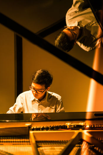 Man in glasses playing Piano Elegant Enjoying Life Flare Fun Glasses Handsome Instruments Insturuments TakeoverMusic Light And Shadow Man Music Music Brings Us Together Musician Piano Portrait Reflection Reflections Relaxing Song Stage Stage - Performance Space Stagephotography Warm Fresh on Market 2016 Piano Moments The Portraitist - 2018 EyeEm Awards