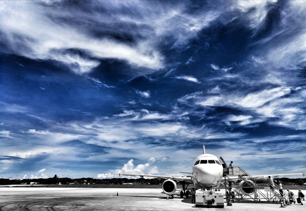 airplane, cloud - sky, sky, transportation, airport, air vehicle, mode of transport, travel, airport runway, outdoors, commercial airplane, day, aerospace industry, no people