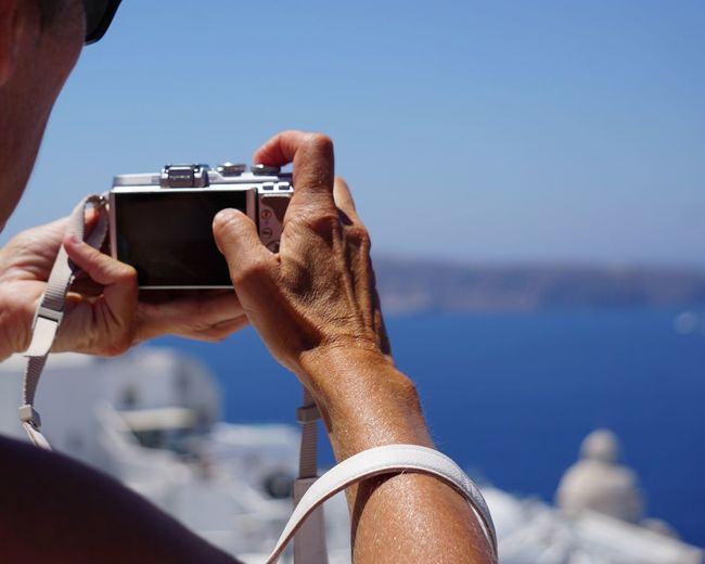 photographing Thira Photography Photographer Shooting Shooting Photos View Santorini Thira Fira EyeEm Selects Human Hand Photography Themes Water Clear Sky Sea Photographing Technology Summer Camera - Photographic Equipment Holding Digital Single-lens Reflex Camera Filming Digital Camera