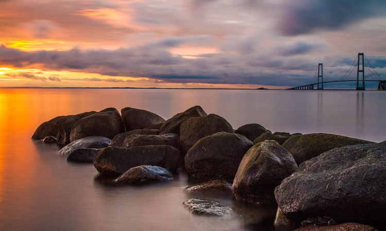 The result from previous photo 🌅😎 Water Sea Sky Sunset Cloud - Sky Scenics - Nature Beauty In Nature No People Rock - Object Land Dusk Solid Rock Dramatic Sky Idyllic Tranquility Tranquil Scene Nature Beach Horizon Over Water