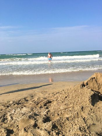 TCPM Sea Beach Water One Person Horizon Over Water Wave Sand Nature Real People Vacations Beauty In Nature Scenics Day Full Length Leisure Activity Sky Outdoors Men People