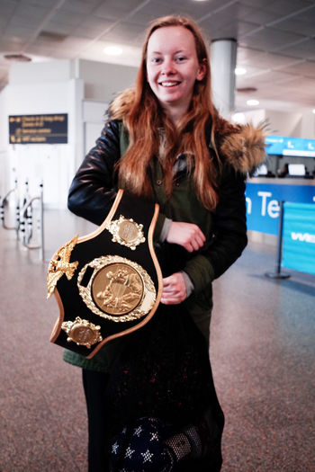champion Athlete Champion Everyday Joy Postcode Postcards Proud Airport Beautiful Woman Belt  Everybodystreet Girl Happiness Looking At Camera One Person Portrait Smiling Standing Winner Young Adult