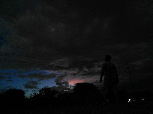 The power of artistic mind ~ Silhouette Dramatic Sky One Man Only Dark Night Thunderstorm Outdoors Cloud - Sky Sky Creativity Darkness And Light From My Point Of View Exceptional Photographs Check This Out Art Beauty In Nature Philippines Eyeem Philippines Silence Of Nature First Eyeem Photo Exploring Photography Dramatic Landscape Landscape Rural Life The Great Outdoors - 2017 EyeEm Awards Live For The Story