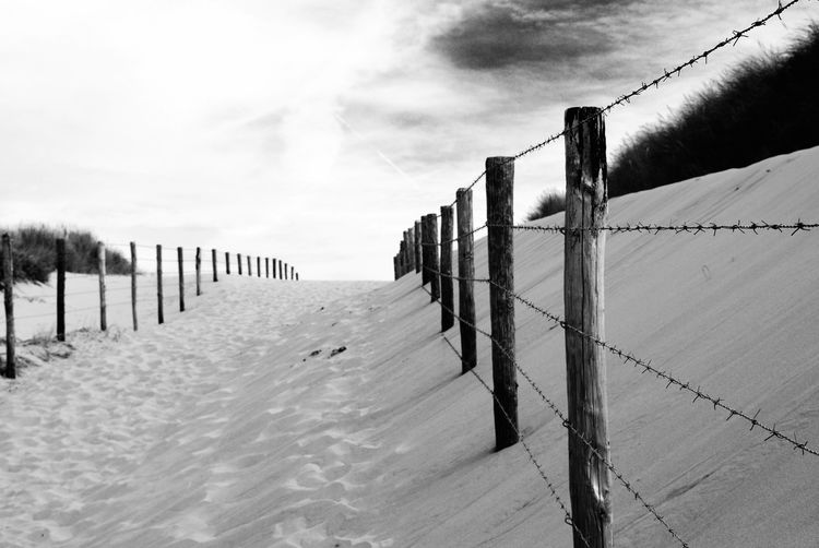 Fence on snow covered ground