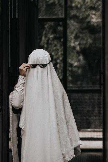 Woman wearing blanket standing outdoors
