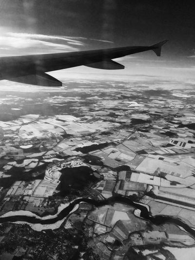 wintery landscape seen from an airplane above Potsdam, Brandenburg, Germany Aerial View Air Vehicle Aircraft Wing Airplane Airplane Wing Beauty In Nature Blackandwhite Day Flying Journey Landscape Mid-air Mode Of Transport Nature No People Outdoors Scenics Sky Tranquility Transportation Travel Vehicle Part