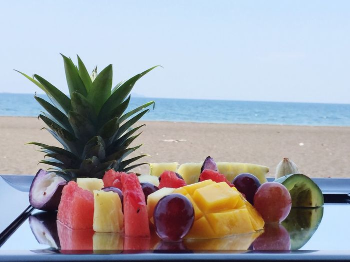 Close-up of fruit salad served on beach