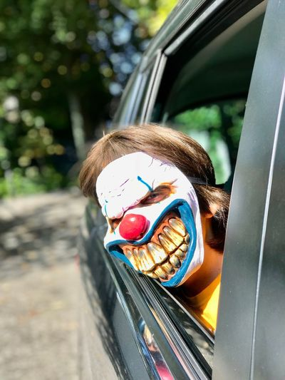 Car Day Outdoors Transportation Real People Land Vehicle One Person Childhood Sweet Food Close-up Animal Themes People Halloween Jack O Lantern Mask Horror Party Spooky Scary Halloween Horrors Blood Party Time Leisure Activity Maskarade Entertainment
