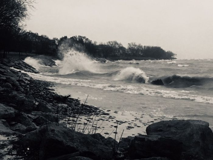 Sea Wave Water Motion Rock Land Rock - Object Solid Beauty In Nature Beach Power In Nature Nature Power Sport Aquatic Sport No People Sky Scenics - Nature Outdoors Breaking Wind Hitting Flowing Water
