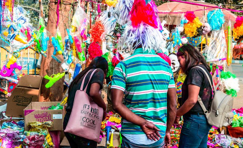 People standing in multi colored umbrellas