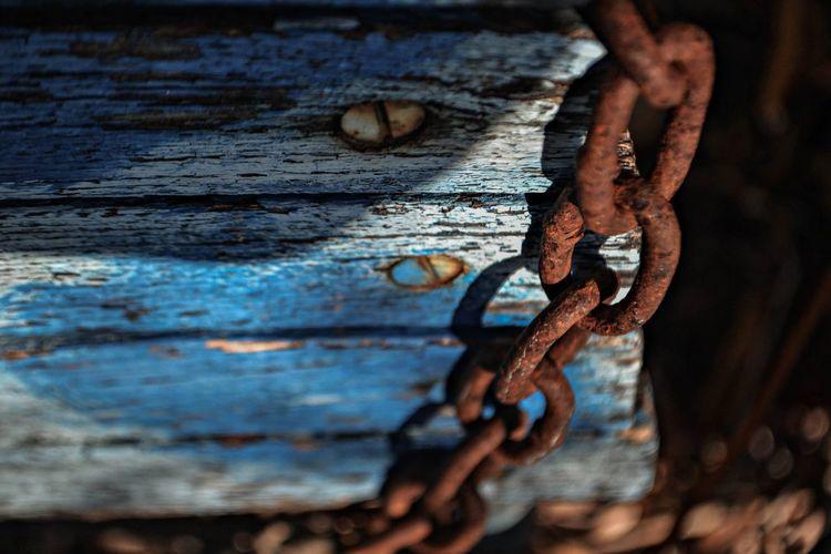 Close-up of rusty metallic chain