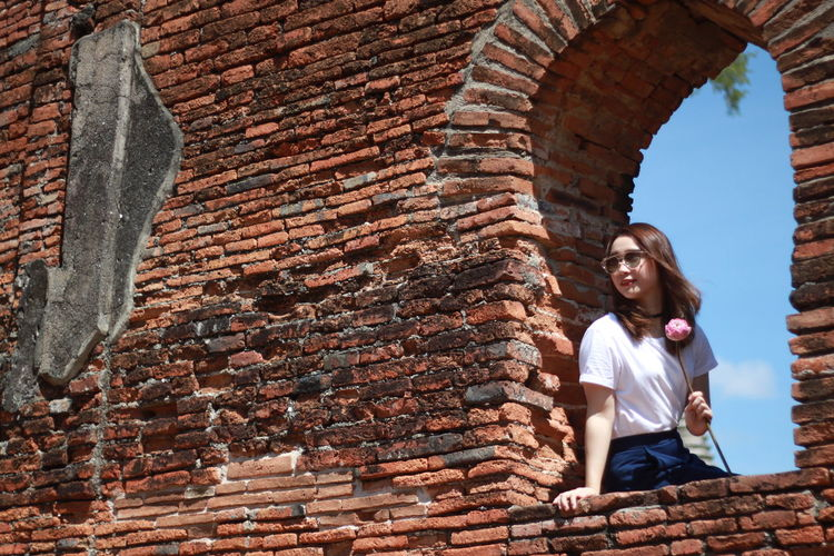 Visit the historic site Ayutthaya. Brick Wall Thailand Architecture Lifestyles Old Ruin Real People Vacations Young Women