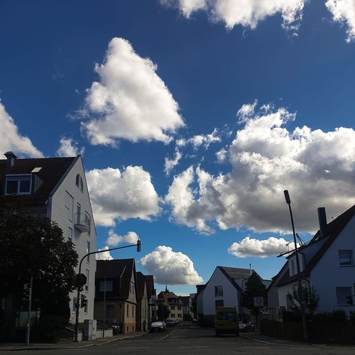 Houses and buildings against sky