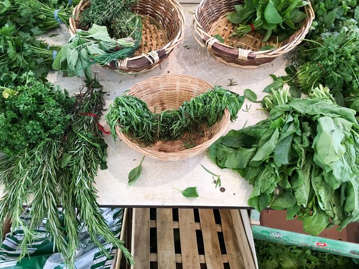 High angle view of various leaf vegetables at market stall