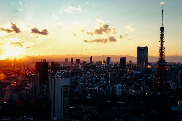 High angle view of cityscape and tokyo tower during sunset