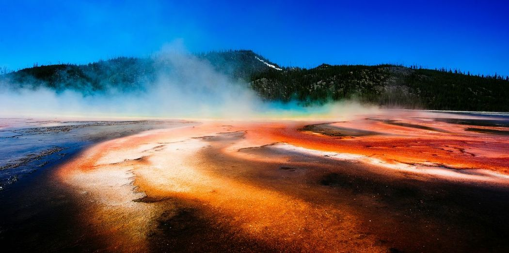 Idyllic Shot Of Hot Spring With Smoke At Yellowstone National Park Against Sky