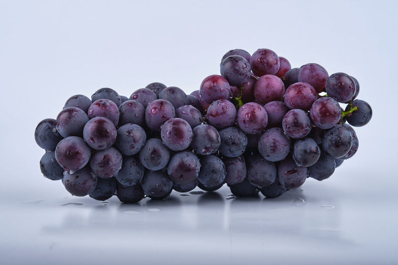 Close-up of grapes against white background