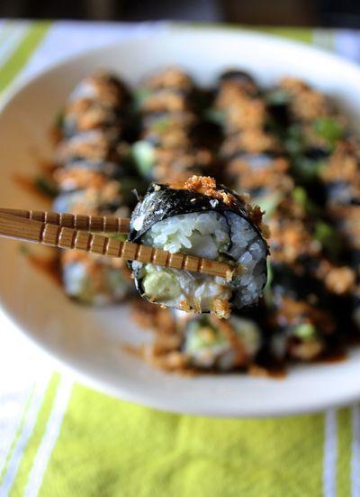 Close-up of chopsticks holding sushi