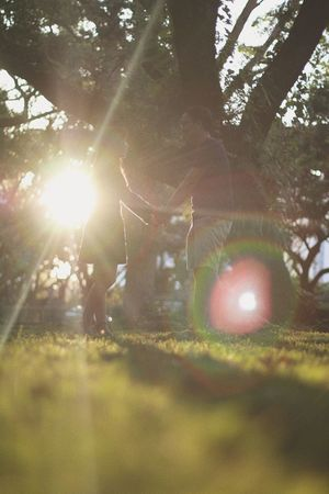 Branch Day Leisure Activity Lens Flare Lifestyles Men Nature Outdoors People Playing Real People Selective Focus Sunlight Togetherness Tree