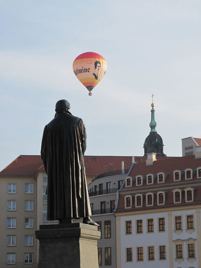 Martin Luther Architecture Building Exterior Built Structure City Clear Sky Day Hot Air Balloon Low Angle View Mid-air Outdoors Real People Sculpture Sky Statue Tourism Travel Destinations