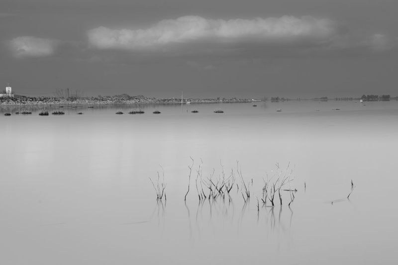 Water Sky Cloud - Sky Tranquility Reflection No People Waterfront Nature Scenics - Nature Tranquil Scene Beauty In Nature Day Lake Outdoors Non-urban Scene Nautical Vessel Idyllic Long Exposure Blackandwhite Black And White Black & White
