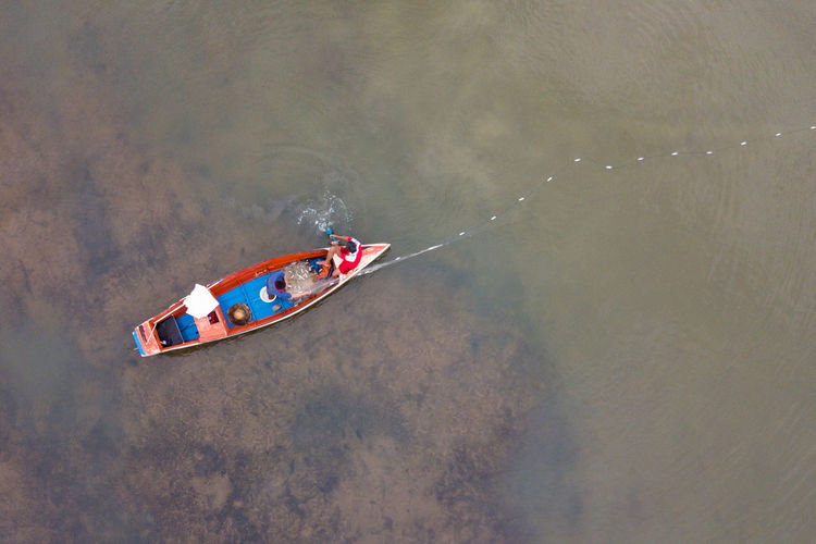 High angle view of man in boat on lake