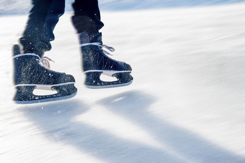 Close-up of ice skater's feet on ice rink Close-up Cold Temperature Day Human Body Part Ice Ice Rink Ice Skate Ice-skating Low Section One Person Outdoors People Shoe Snow Snowboarding Sport Warm Clothing Winter Winter Sport