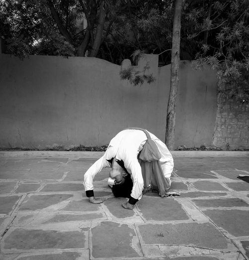 Rear view of man doing dance with yoga